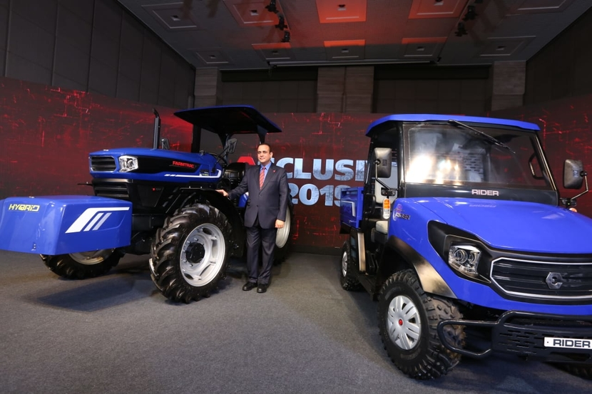 Nikhil Nanda with the newly launched India's first hybrid concept tractor and RTV.