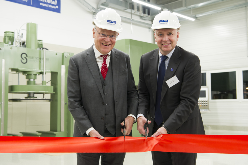 Stephan Weil Minister President of Lower Saxony left and Dirk Bremm President of BASFs Coatings division inaugurate the expansion of the Chemetall site in Langelsheim Germany